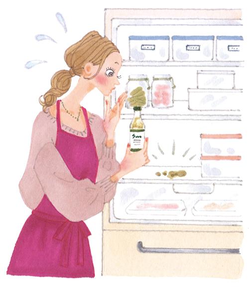 女性が冷蔵庫の汚れを発見したイラストです。