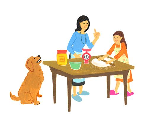 食事の準備をするお母さんと娘