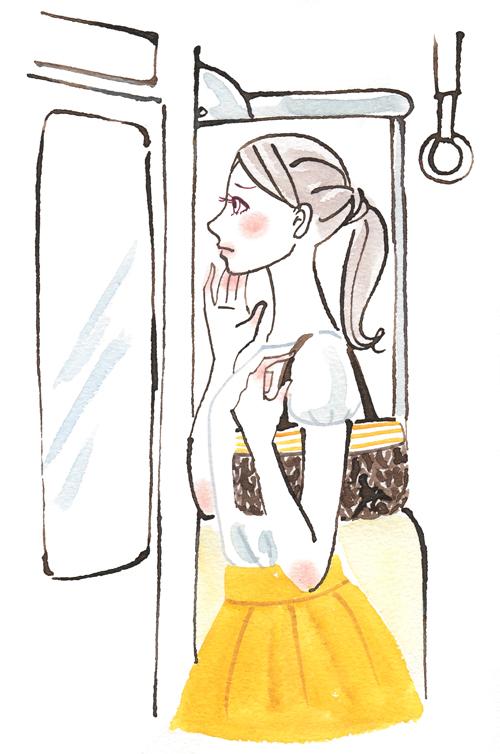 電車で肌を見ている女性