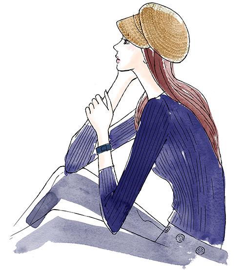 座って考えて事をする女性の横向き姿