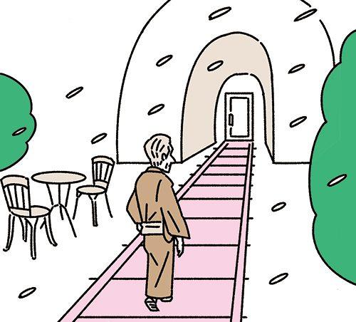 線路上を歩く川端康成風の男性