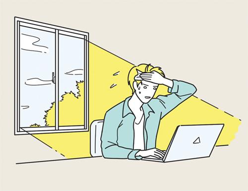 暑さが厳しい中で仕事する男性のイラスト